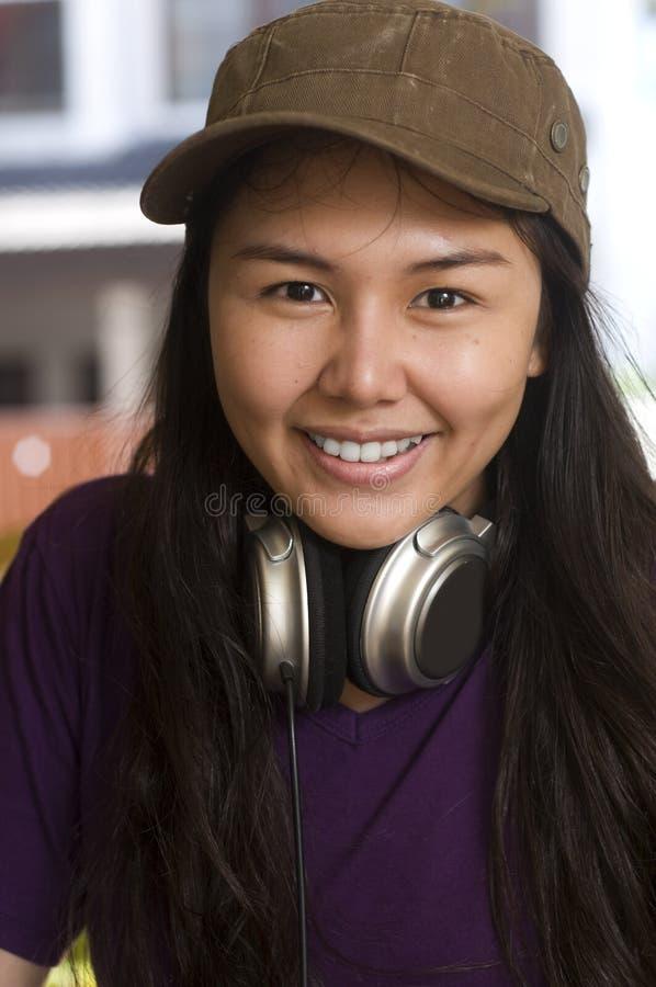 Adolescente asiático feliz foto de stock
