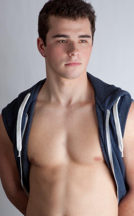Adolescente atractivo, muscular fotografía de archivo libre de regalías