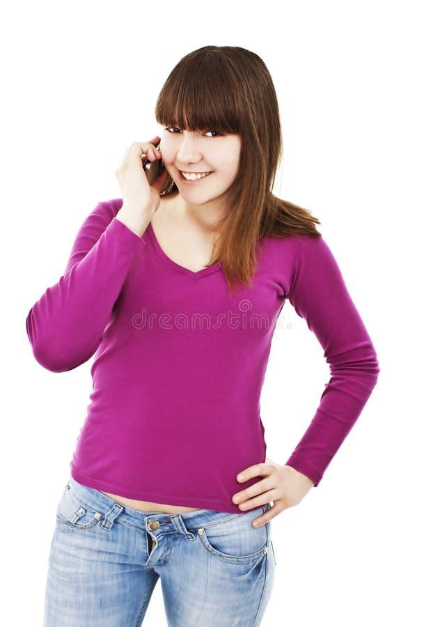 Adolescente attraente che comunica sul telefono immagini stock libere da diritti