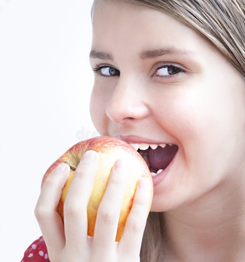 Adolescente avec Apple photo stock