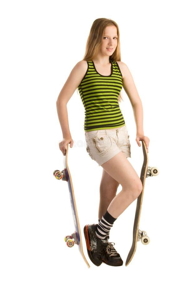 Adolescente avec deux planches à roulettes photographie stock libre de droits