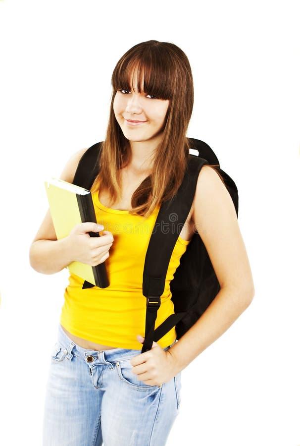 Adolescente avec le sac à dos et le livre photo libre de droits