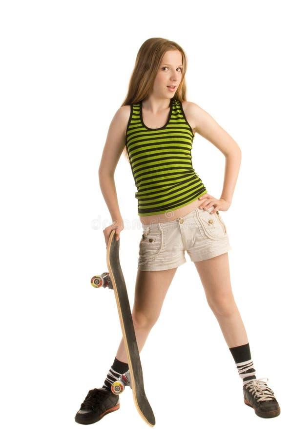Adolescente avec une planche à roulettes photos stock
