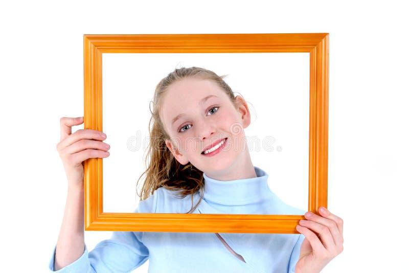 Adolescente bonito em um frame imagens de stock