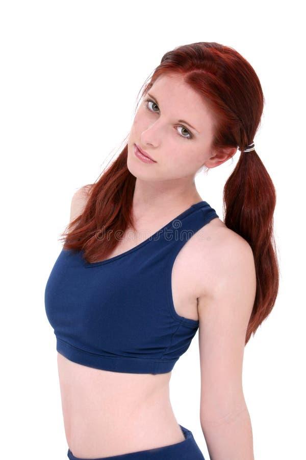 Adolescente bonito na roupa do exercício sobre o branco imagem de stock royalty free