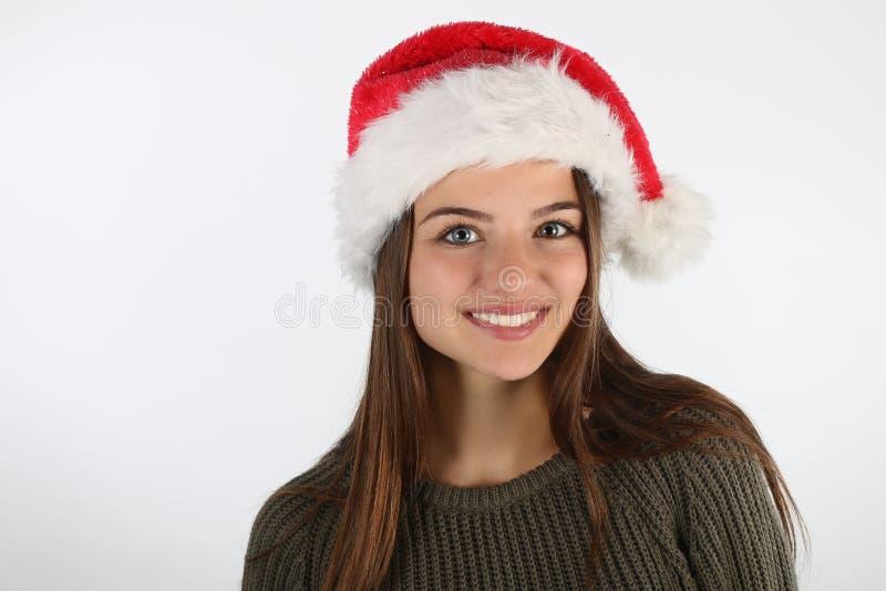 Adolescente bonito que veste um chapéu de Santa fotografia de stock royalty free