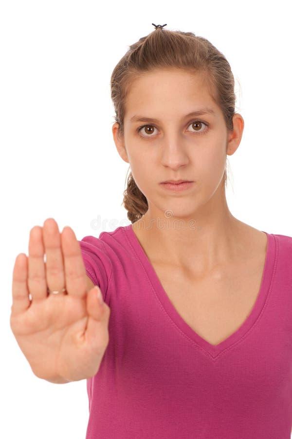 Adolescente che gesturing il fanale di arresto fotografia stock libera da diritti