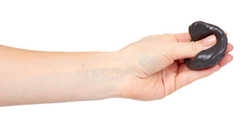 Adolescente che gioca melma nera con la mano, giocattolo trasparente fotografia stock libera da diritti