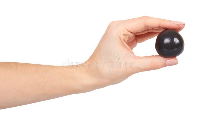 Adolescente che gioca melma nera con la mano, giocattolo trasparente immagini stock libere da diritti