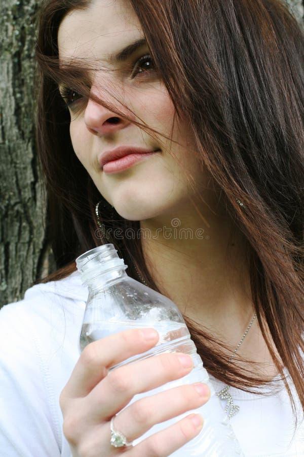 Adolescente com água imagem de stock