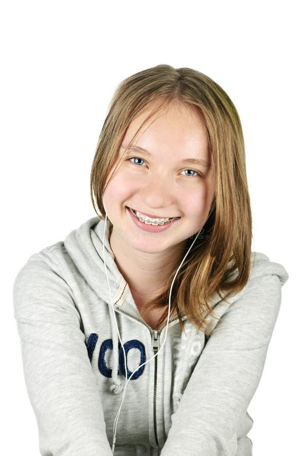 Adolescente com fones de ouvido fotos de stock royalty free