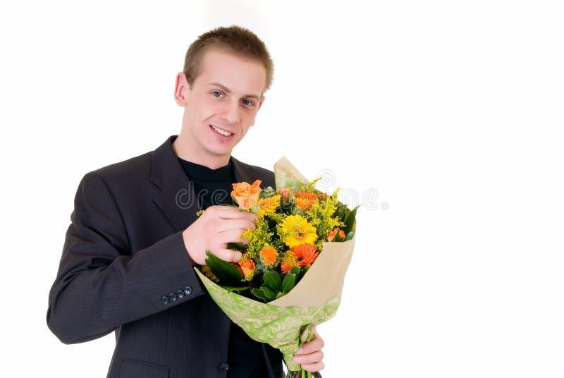 Adolescente com o ramalhete das flores imagens de stock