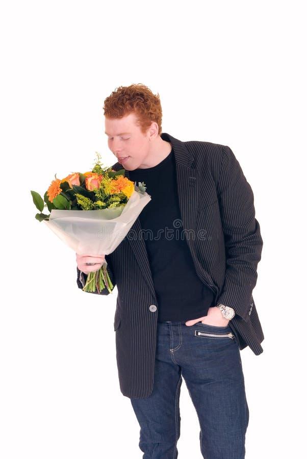 Adolescente com o ramalhete das flores fotos de stock royalty free