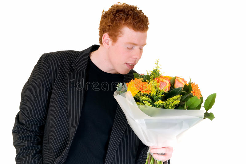 Adolescente com o ramalhete das flores foto de stock royalty free