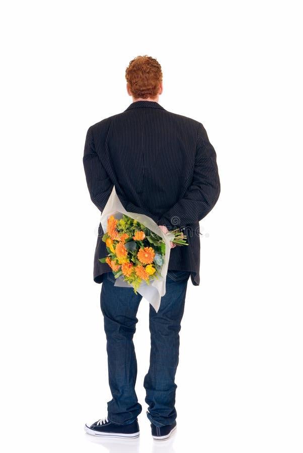 Adolescente com o ramalhete das flores fotografia de stock royalty free