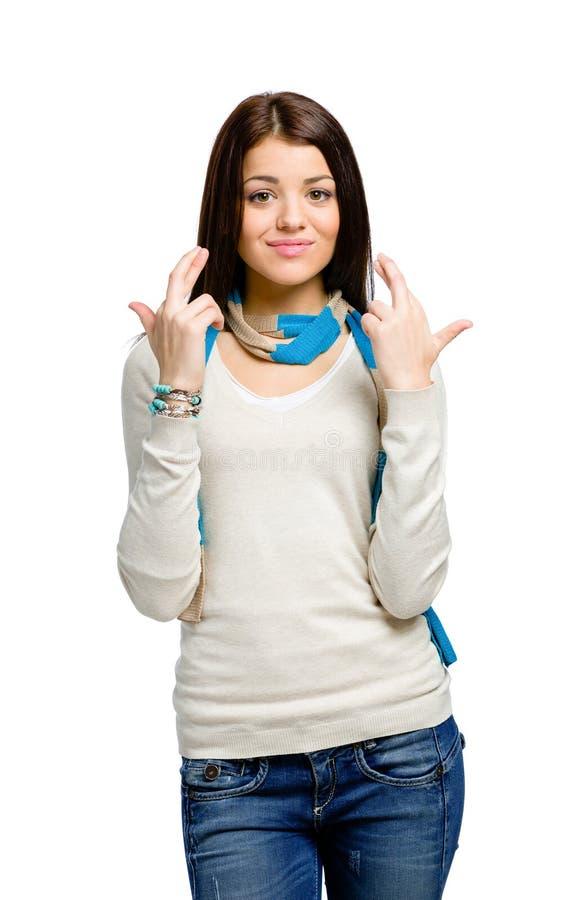 Adolescente com os dedos cruzados imagens de stock