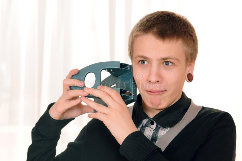 Adolescente com perfurador fotos de stock