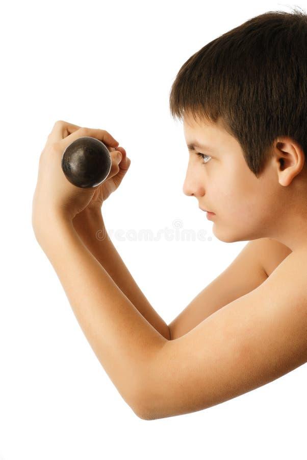 Adolescente com pesos fotos de stock