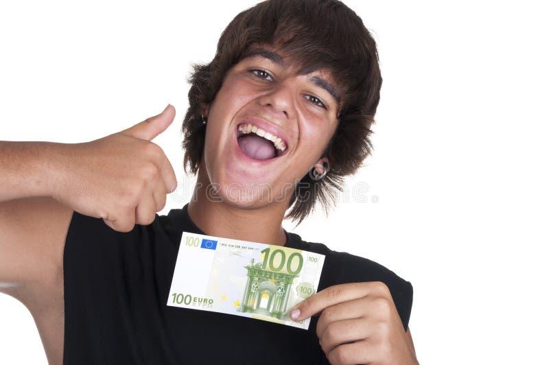 Adolescente com um bilhete de 100 euro foto de stock