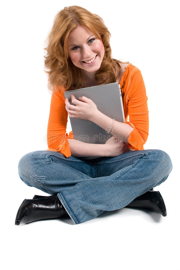 Adolescente com um computador imagem de stock royalty free