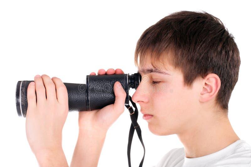 Adolescente con il monocolo immagini stock libere da diritti