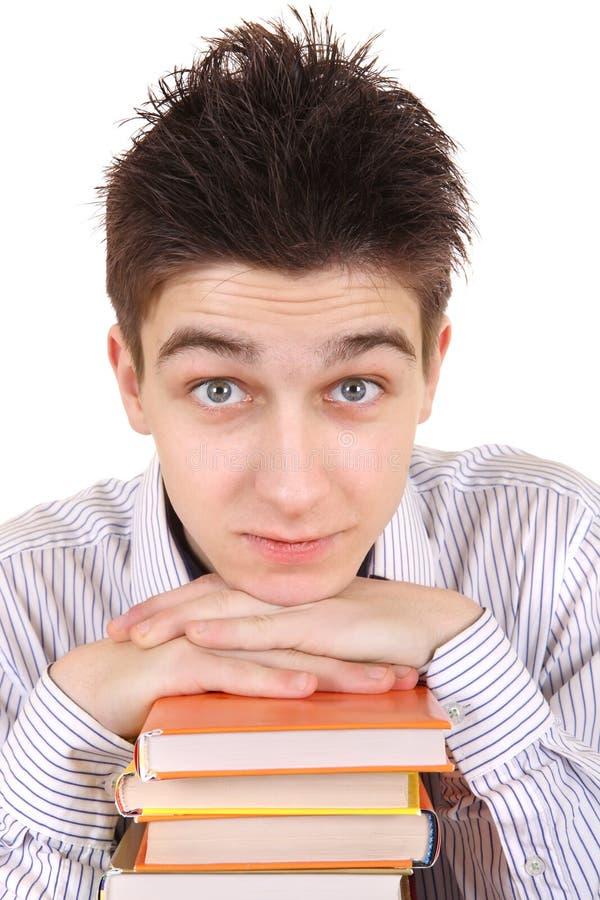 Adolescente con los libros imagen de archivo