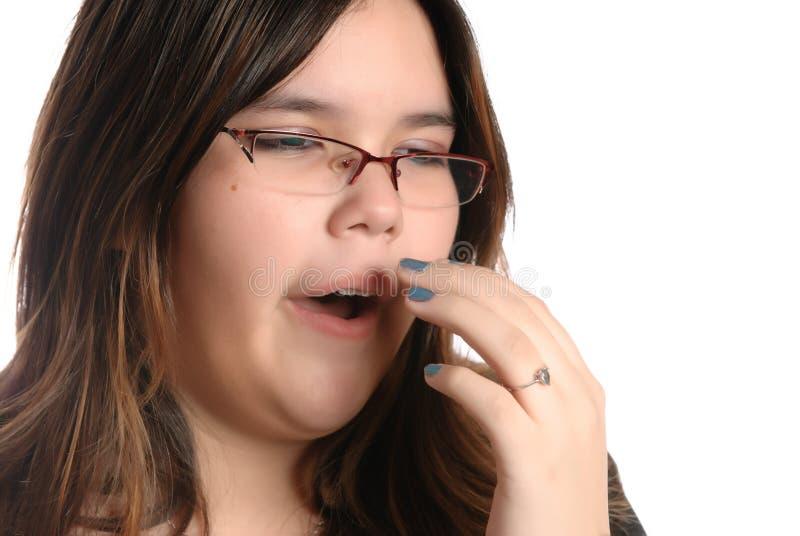 Adolescente de bocejo imagem de stock