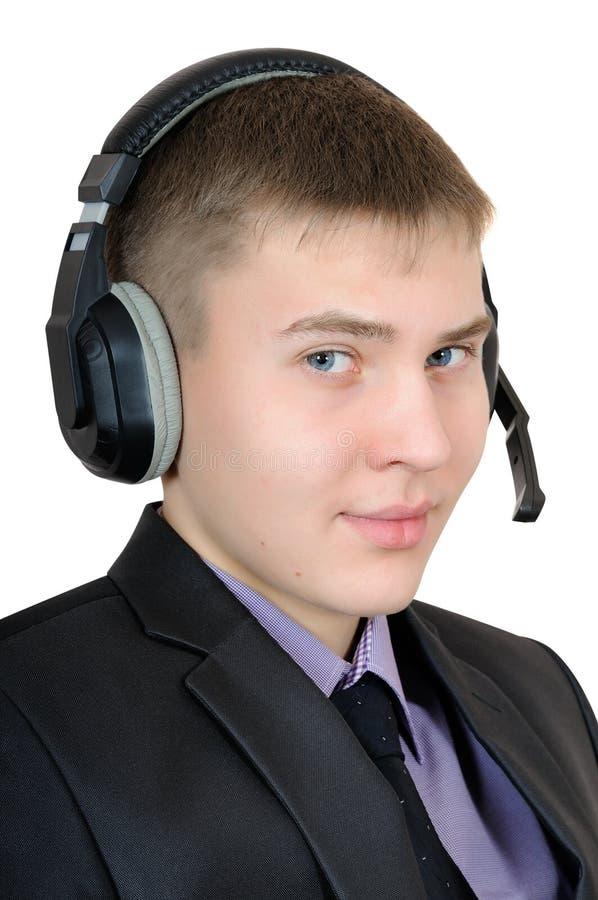 Adolescente de dezessete anos nos fones de ouvido fotos de stock royalty free