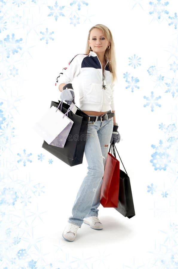 Adolescente de las compras con los copos de nieve fotografía de archivo