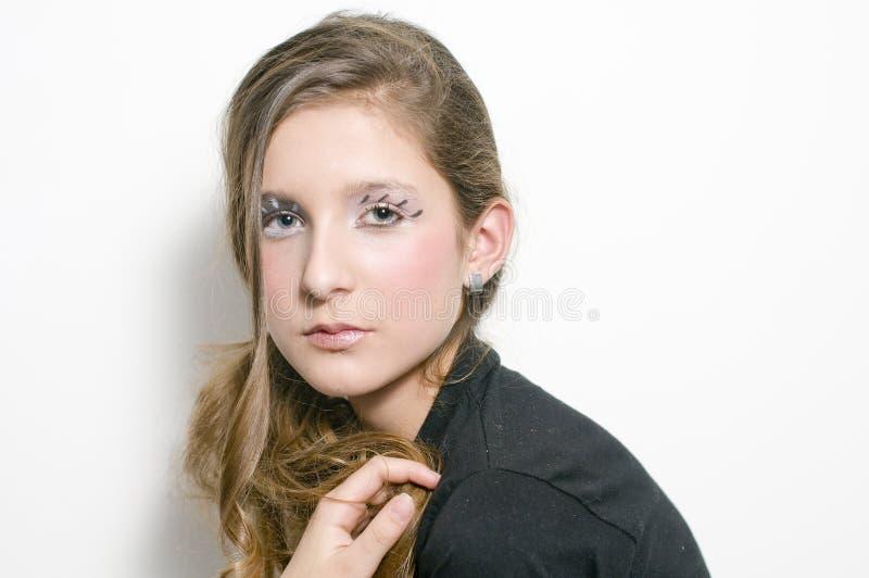 Adolescente de mode avec les jeux spéciaux d'oeil photos stock