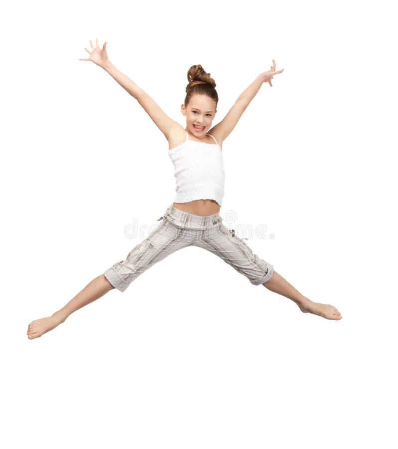 Adolescente de salto foto de stock
