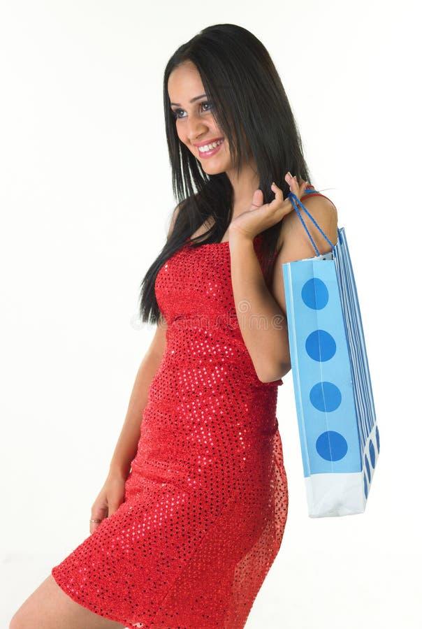Adolescente de sorriso com saco de compra fotos de stock