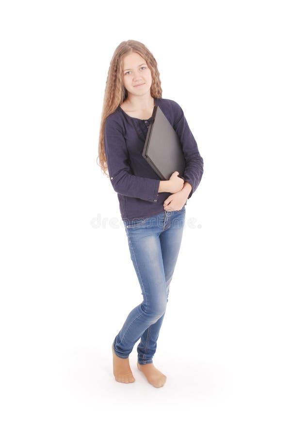 Adolescente de sorriso do estudante com portátil imagem de stock royalty free