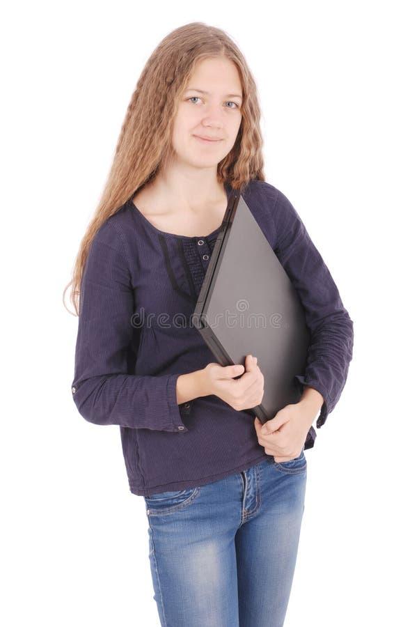Adolescente de sorriso do estudante com portátil imagens de stock