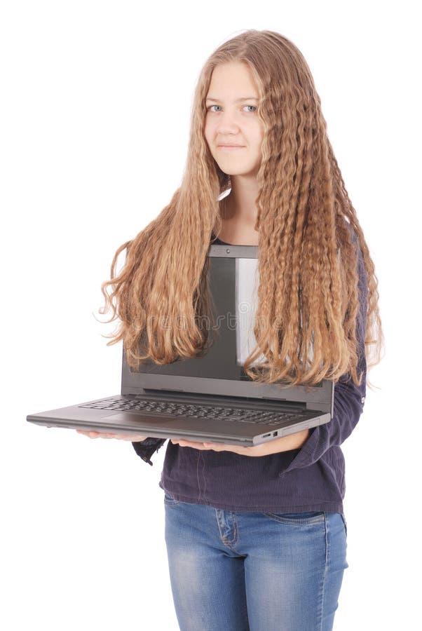 Adolescente de sorriso do estudante com portátil foto de stock