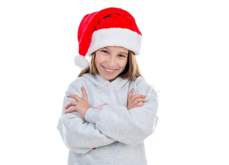Adolescente de sorriso no chapéu de Santa fotos de stock royalty free