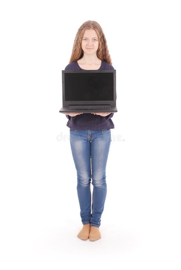 Adolescente de sourire d'étudiant avec l'ordinateur portable image libre de droits
