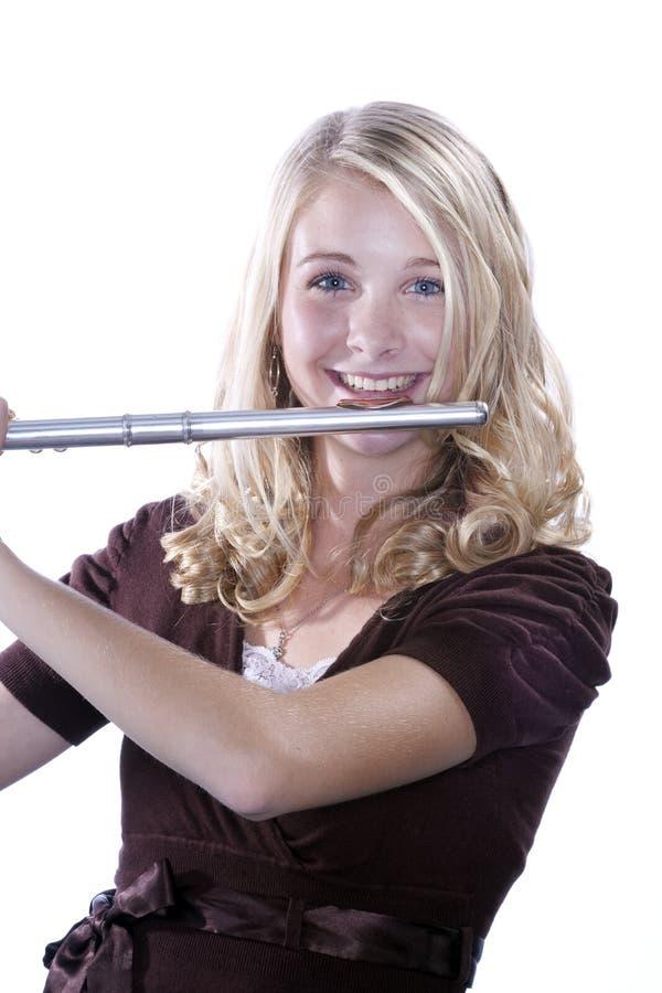 Adolescente do jogador de flauta no branco fotografia de stock