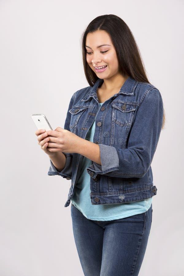 Download Adolescente E Telefone Celular Foto de Stock - Imagem de relaxation, cellphone: 65580650