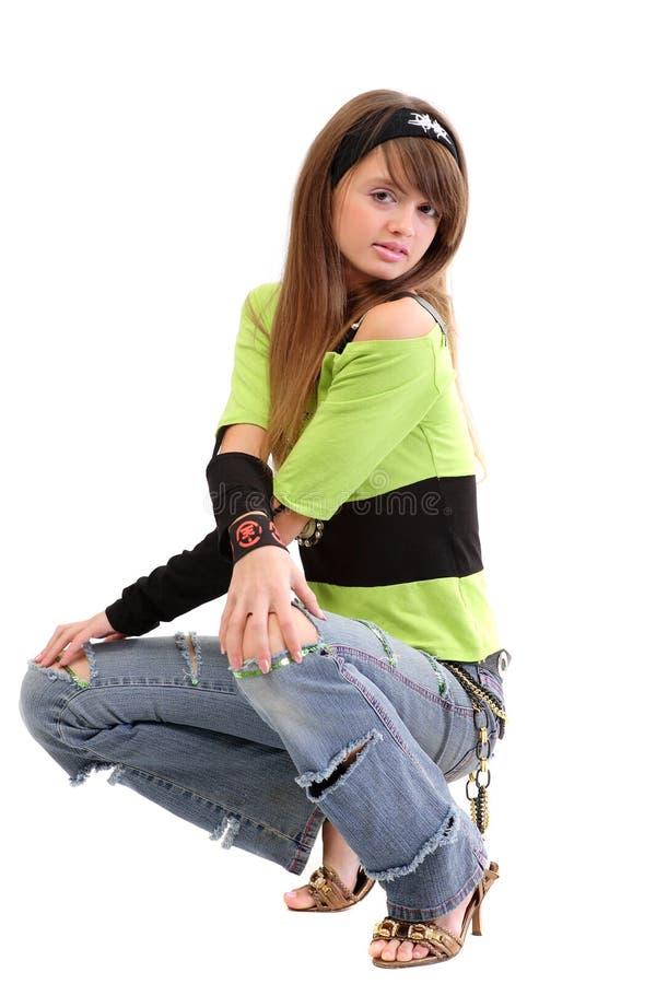 Adolescente em bluejeans rasgados imagem de stock