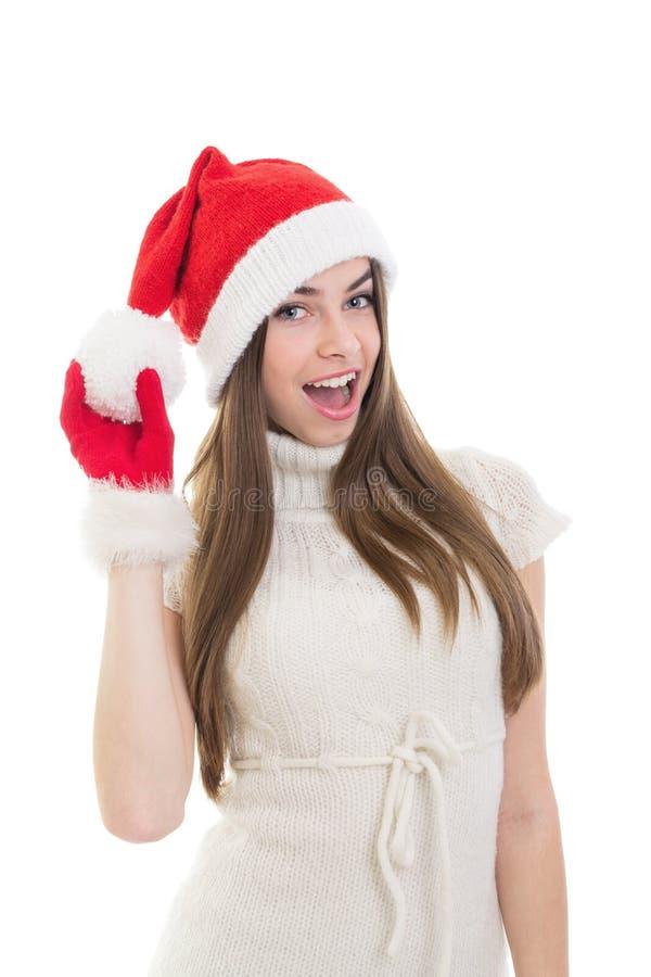 Adolescente emocionado lindo con el sombrero de Papá Noel imágenes de archivo libres de regalías