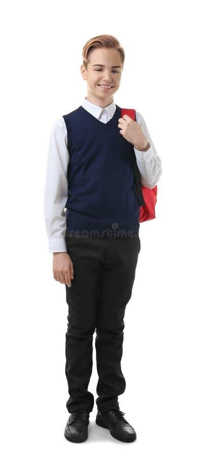 Adolescente en uniforme escolar con la mochila fotos de archivo