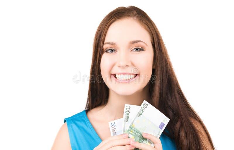 Adolescente encantador com dinheiro fotografia de stock royalty free