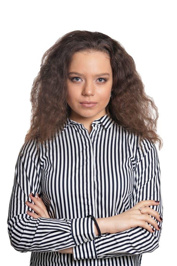 Adolescente encaracolado bonito em camisa preto e branco listrada isolada fotografia de stock royalty free