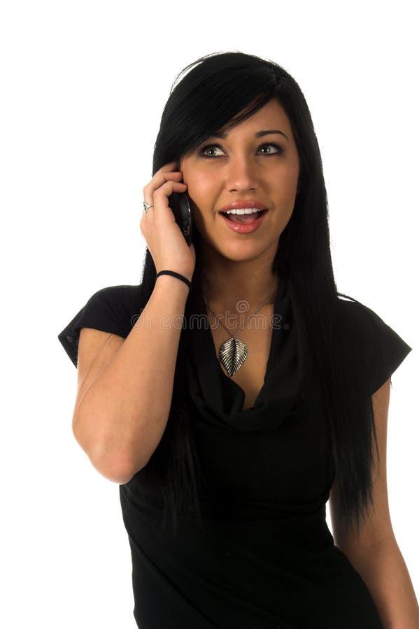 Adolescente Excited no telefone de pilha fotografia de stock