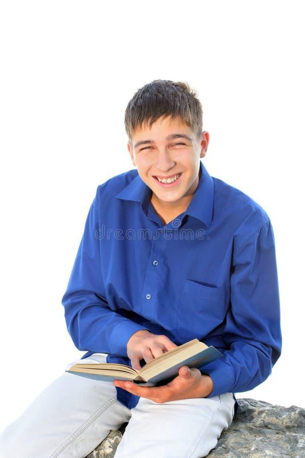 Adolescente feliz com livro imagens de stock royalty free