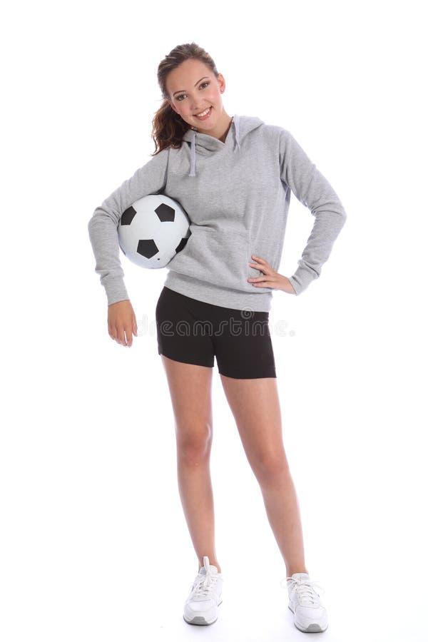 Adolescente feliz del jugador de fútbol con la bola de los deportes imagen de archivo
