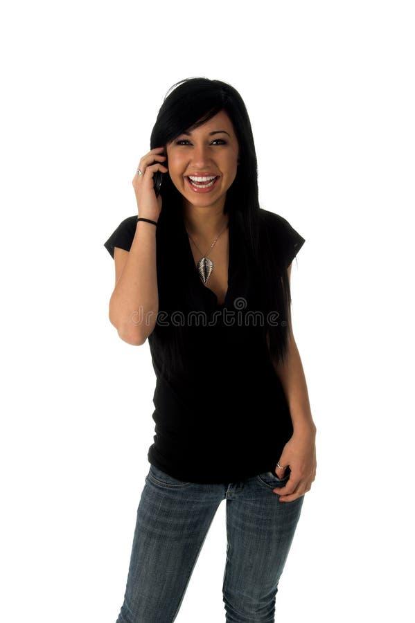 Adolescente feliz no telefone de pilha fotografia de stock royalty free