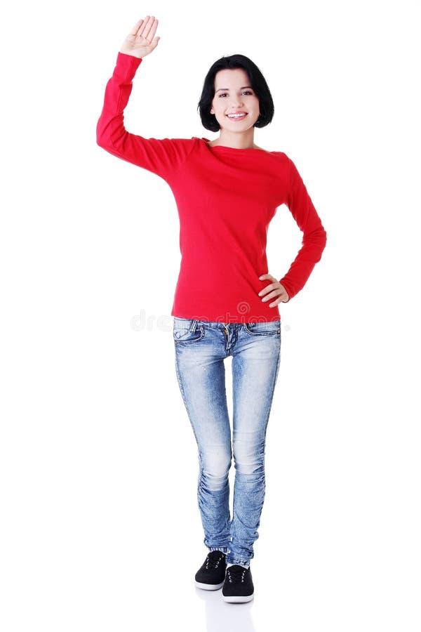 Download Adolescente Feliz Que Acena Um Cumprimento Foto de Stock - Imagem de palma, cheerful: 29827430
