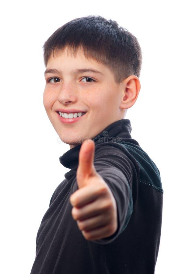 Adolescente feliz que mostra os polegares acima fotos de stock royalty free